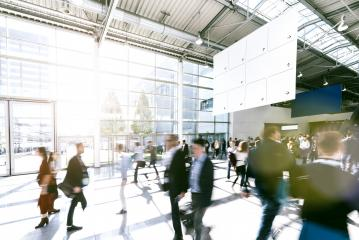 blurred business people at a trade fair- Stock Photo or Stock Video of rcfotostock   RC-Photo-Stock