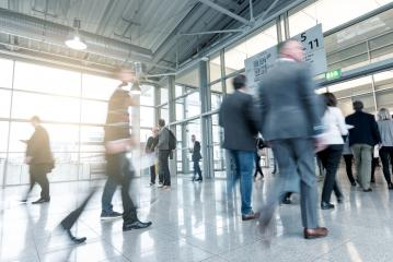 Blurred business people at a trade fair entrance - Stock Photo or Stock Video of rcfotostock | RC-Photo-Stock