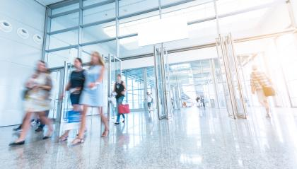 Blurred business people at a trade fair entrance- Stock Photo or Stock Video of rcfotostock | RC-Photo-Stock