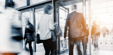 blurred business people at a trade fair entrance- Stock Photo or Stock Video of rcfotostock   RC-Photo-Stock
