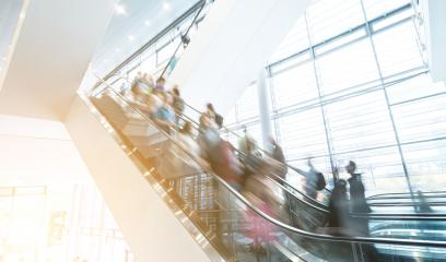 Blurred business people at a trade fair escalators in motion- Stock Photo or Stock Video of rcfotostock   RC-Photo-Stock