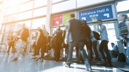 Blurred business people at a trade fair, expo- Stock Photo or Stock Video of rcfotostock | RC-Photo-Stock