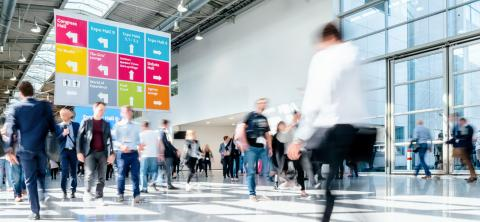 blurred business people at a trade fair hall- Stock Photo or Stock Video of rcfotostock | RC-Photo-Stock