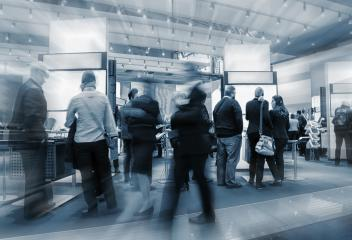 Blurred business people at a trade fair stand- Stock Photo or Stock Video of rcfotostock | RC-Photo-Stock