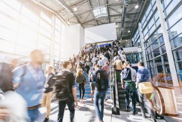 blurred business people at a trade fair, with banner for copy space- Stock Photo or Stock Video of rcfotostock | RC-Photo-Stock