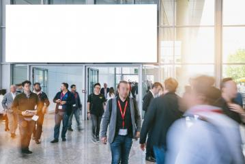 blurred business people at a trade show, with copy space banner- Stock Photo or Stock Video of rcfotostock | RC-Photo-Stock
