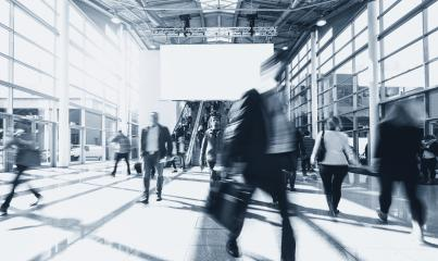 blurred business people at rushing at a trade fair- Stock Photo or Stock Video of rcfotostock | RC-Photo-Stock