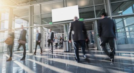 Blurred business people in a modern hall- Stock Photo or Stock Video of rcfotostock | RC-Photo-Stock