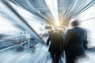 Blurred business people using a escalator on a  trade fair / messe- Stock Photo or Stock Video of rcfotostock   RC-Photo-Stock