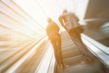 Blurred business people using a skywalk/staircase- Stock Photo or Stock Video of rcfotostock | RC-Photo-Stock