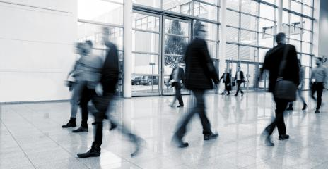 blurred business people walking in a modern hall at a International Trade Fair- Stock Photo or Stock Video of rcfotostock | RC-Photo-Stock
