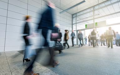 blurred Business people walking in the trade fair corridor- Stock Photo or Stock Video of rcfotostock | RC-Photo-Stock