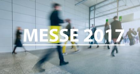 blurred Business people walking on a trade fair - text Concept image (Messe 2017)- Stock Photo or Stock Video of rcfotostock | RC-Photo-Stock