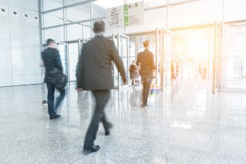 Blurred business people walking on a trade show- Stock Photo or Stock Video of rcfotostock | RC-Photo-Stock