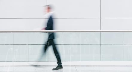 blurred businessman walking in a floor- Stock Photo or Stock Video of rcfotostock | RC-Photo-Stock
