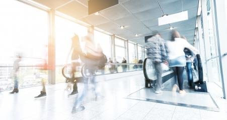 blurred commuters walking at a airport entrance - Stock Photo or Stock Video of rcfotostock | RC-Photo-Stock
