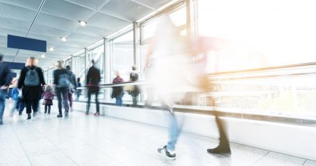 blurred commuters walking at a stradeshow- Stock Photo or Stock Video of rcfotostock | RC-Photo-Stock