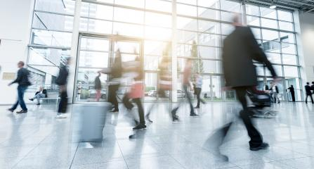 blurred commuters walking in a modern traid fair hall- Stock Photo or Stock Video of rcfotostock | RC-Photo-Stock