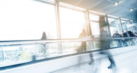 blurred commuters walking on a escalator- Stock Photo or Stock Video of rcfotostock | RC-Photo-Stock