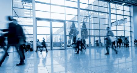 blurred Exhibition visitors walking in a modern hall- Stock Photo or Stock Video of rcfotostock | RC-Photo-Stock