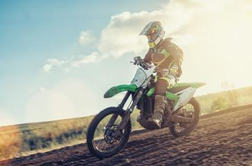 blurred motion Motocross MX rider racing on a dirt track- Stock Photo or Stock Video of rcfotostock | RC-Photo-Stock