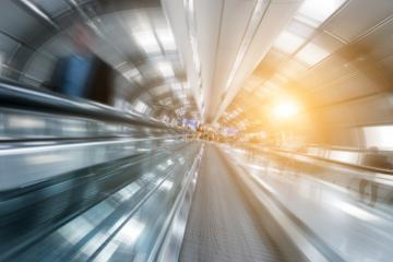 Blurred passengers on a futuristic airport walkway- Stock Photo or Stock Video of rcfotostock | RC-Photo-Stock