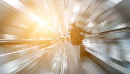blurred passengers on a walkway tunnel- Stock Photo or Stock Video of rcfotostock | RC-Photo-Stock