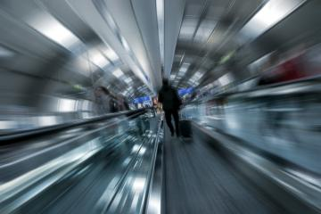 Blurred passengers using a escalator- Stock Photo or Stock Video of rcfotostock | RC-Photo-Stock