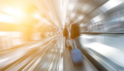 blurred passengers using a skywalk/staircase at a airport- Stock Photo or Stock Video of rcfotostock | RC-Photo-Stock