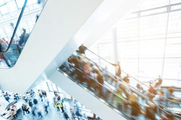 blurred people at a trade fair staircase- Stock Photo or Stock Video of rcfotostock   RC-Photo-Stock