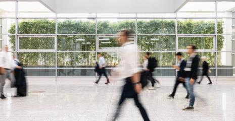 Blurred people go by hall to trade fair- Stock Photo or Stock Video of rcfotostock | RC-Photo-Stock