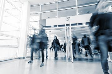 blurred people in a modern trade fair hall - Stock Photo or Stock Video of rcfotostock | RC-Photo-Stock