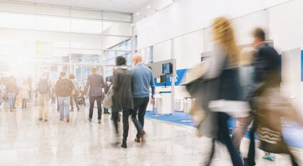 blurred people rushing at a trade fair hall- Stock Photo or Stock Video of rcfotostock | RC-Photo-Stock