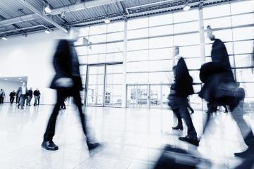 blurred people rushing in a trade show hall- Stock Photo or Stock Video of rcfotostock | RC-Photo-Stock