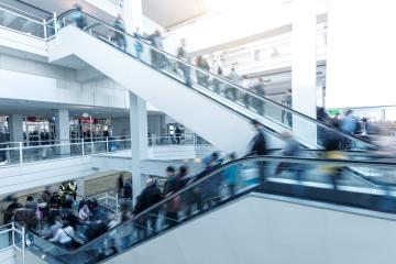 Blurred people using a escalator on a European Trade Fair- Stock Photo or Stock Video of rcfotostock | RC-Photo-Stock