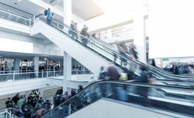 Blurred people using a escalator on a International Trade Fair- Stock Photo or Stock Video of rcfotostock | RC-Photo-Stock