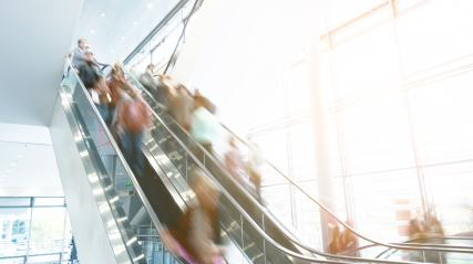 Blurred people using a escalators at a shopping center- Stock Photo or Stock Video of rcfotostock | RC-Photo-Stock