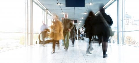 Blurred people using a modern walkway at a fair- Stock Photo or Stock Video of rcfotostock | RC-Photo-Stock