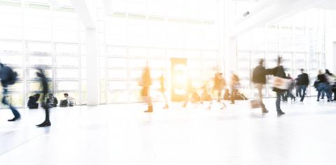 Blurred people using a walkway at a tradeshow- Stock Photo or Stock Video of rcfotostock | RC-Photo-Stock
