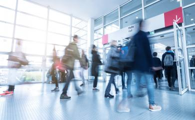 Blurred people walking at a trade fair entrance - Stock Photo or Stock Video of rcfotostock | RC-Photo-Stock