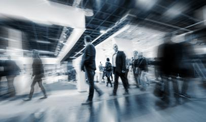 blurred people walking at a Trade Fair hall- Stock Photo or Stock Video of rcfotostock   RC-Photo-Stock