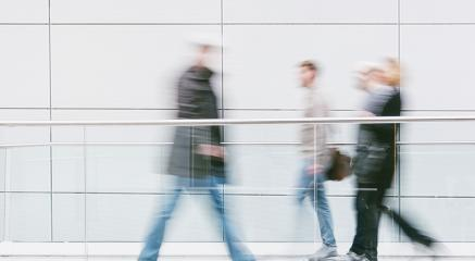 blurred people walking in a corridor at fait hall- Stock Photo or Stock Video of rcfotostock | RC-Photo-Stock
