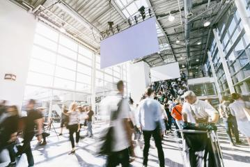 blurred people walking in a modern hall of a trade fair- Stock Photo or Stock Video of rcfotostock | RC-Photo-Stock