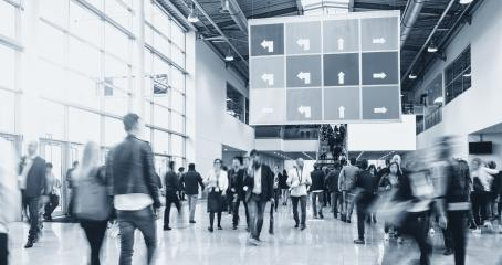 blurred people walking in a modern hall of a trade fair- Stock Photo or Stock Video of rcfotostock   RC-Photo-Stock