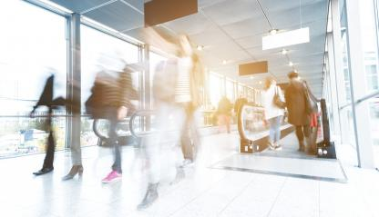 blurred people walking in a modern traid fair entrance- Stock Photo or Stock Video of rcfotostock | RC-Photo-Stock