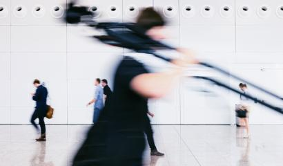 blurred photographer walking with tripod in a floor- Stock Photo or Stock Video of rcfotostock | RC-Photo-Stock
