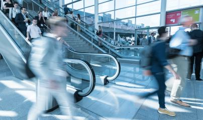 Blurred trade fair visitors using a escalator/stairs- Stock Photo or Stock Video of rcfotostock | RC-Photo-Stock