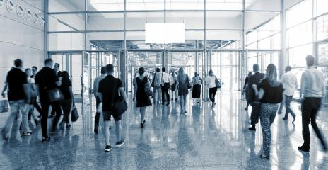 blurred Trade Show visitors walking to a entrance- Stock Photo or Stock Video of rcfotostock | RC-Photo-Stock