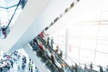 blurred traid fair crowd using a escalator- Stock Photo or Stock Video of rcfotostock | RC-Photo-Stock