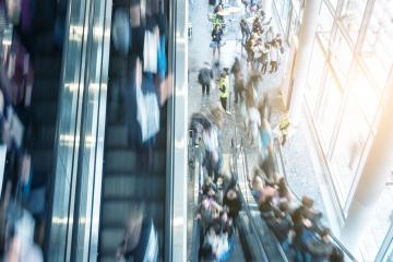blurred traid fair visitors at a escalator- Stock Photo or Stock Video of rcfotostock | RC-Photo-Stock